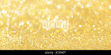 Abstract gold bokeh with snow, Christmas and new year theme background - Stock Photo