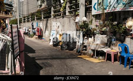 Small Soi Alley  Slum off Soi DianaTrash All Over the Place in Pattaya Thailand - Stock Photo