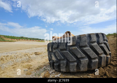 wheel of a truck on the construction site - Stock Photo