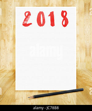 Happy new year 2018 on white paper frame with pencil in hand brush style in wood parquet room,Holiday greeting card,mock - Stock Photo