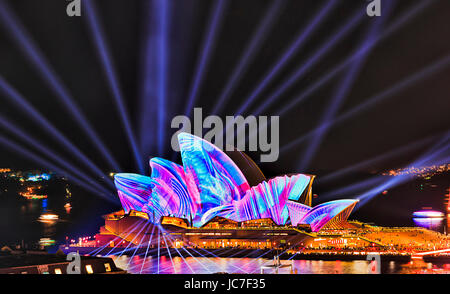 Sydney, Australia - 12 June 2017: Bunch of blue light beams intersecting against the Sydney Opera house during Vivid - Stock Photo