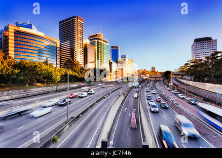 Morning speeding traffic on Warringah freeway goint throug North Sydney during rush hour. Multi-late highway with - Stock Photo