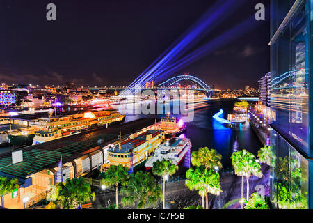 Circular quay, the Rocks and Sydney harbour from elevated lookout towards the Sydney Harbour Bridge during Vivid - Stock Photo