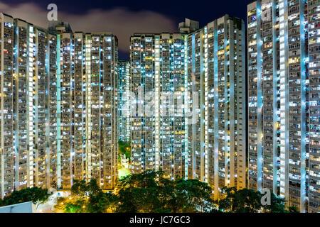 Compact life in Hong Kong at night - Stock Photo