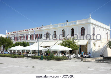ZAKYNTHOS, GREECE - OCTOBER 4 : Cafe terraces and typical greece buildings on the Solomos Square on October 4, 2011 - Stock Photo