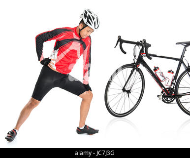 Asian biker warming up or cool down, standing beside bike, isolated on white background. - Stock Photo