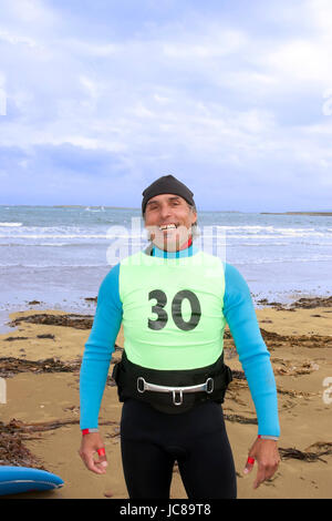 windsurfers getting equipment ready on the beach in the maharees county kerry ireland - Stock Photo