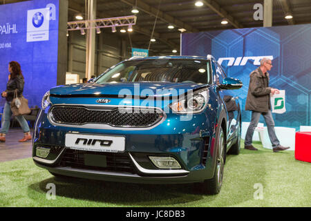 KIEV, UKRAINE - APRIL 07, 2017: People visit Kia Niro hybrid car booth at 2nd International Trade Show of Electric - Stock Photo