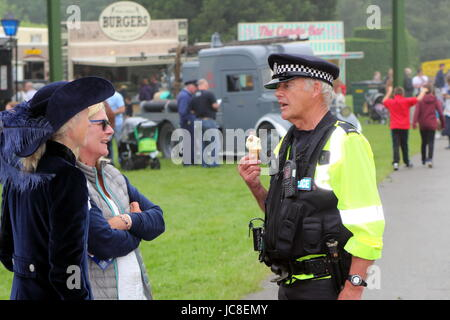 Beaulieu, Hampshire, UK - May 29 2017: UK Police officer talking to the Right Hon. Mary Montagu-Scott and a friend - Stock Photo