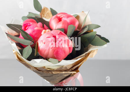 vase of peonies in the foreground. Workshop florist. - Stock Photo
