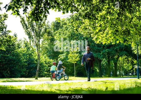 Aberystwyth Wales UK, Wednesday 14 June 2017 UK Weather: People walking and cycling along the tree-lined Plascrug - Stock Photo