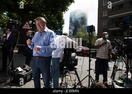 London, UK. 14th June, 2017. TV and other media reporting from near to a blaze at Grenfell Tower near Notting Hill - Stock Photo