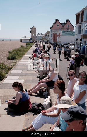 Aldeburgh Suffolk, UK. 14th June, 2017. Visitors enjoy the hot sunny weather and a concert in the bandstand on the - Stock Photo