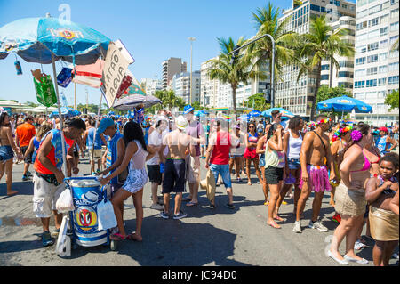 RIO DE JANEIRO - FEBRUARY 19, 2017: Crowds of young people and vendors gather at a morning street party in Copacabana - Stock Photo
