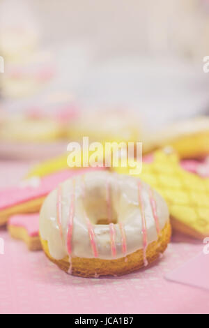 First birthday cookies - cookies and white decorated doughnut, with copy space - Stock Photo