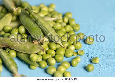 Flat lay pile of fresh green peas closeup macro. - Stock Photo
