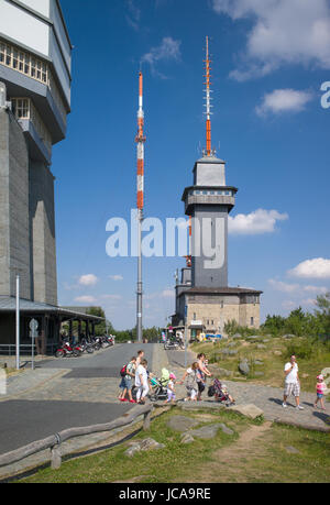 Transmitters and observation tower, with tourists in foreground, on Großer Feldberg, Taunus, Germany - Stock Photo