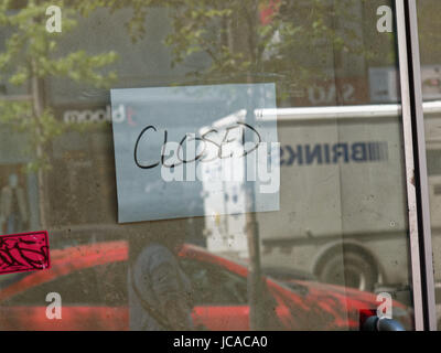 Quebec,Canada. Closed sign on shop door in Montreal - Stock Photo