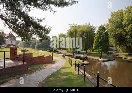 The broad locks in Stourport Basin on the Staffs and Worcs Canal leading to the river Severn in the town of Stourport - Stock Photo