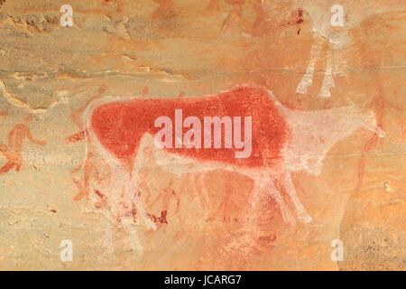 Bushmen (san) rock painting of an eland antelope and human figures, Drakensberg mountains, South Africa - Stock Photo