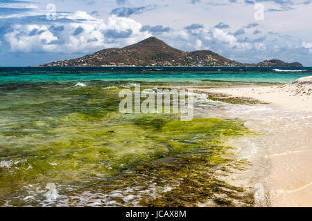 Caribbean View of Petite Martinique from the Shore of Mopian Island: Saint Vincent and the Grenadines. - Stock Photo