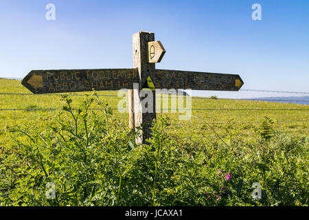 Wooden Signpost to Abbotsham and Bucks Mills on the South West Coast Path, Greencliff Devon, UK. - Stock Photo