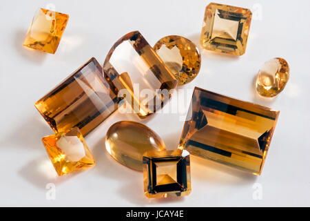 Several yellow citrine stones with different types of cutting - Stock Photo