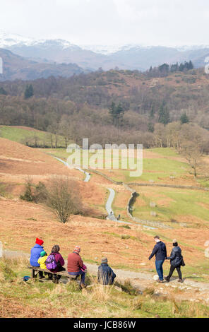 A family looking across Rydal Water near Ambleside, Cumbria, England, UK - Stock Photo
