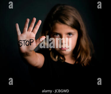 Angry girl, showing hand signaling to stop violence