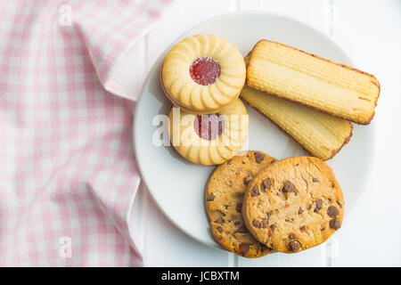 Various sweet biscuits on plate. Top view. - Stock Photo