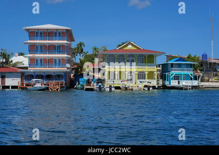 Colorful waterfront colonial houses over the sea with boats at dock, Colon island, Bocas del Toro, Caribbean coast - Stock Photo