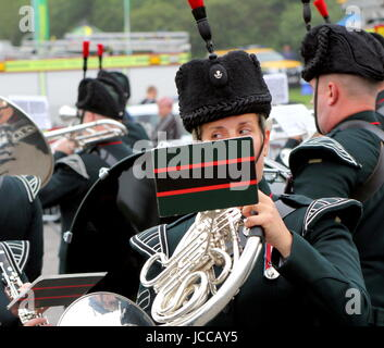 Beaulieu, Hampshire, UK - May 29 2017: Female French Horn player with the Winchester Rifles military band at the - Stock Photo