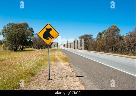 Koala warning sign near the Australian highway - Stock Photo