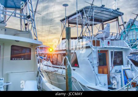 View of Sportfishing boats at Marina early morning - Stock Photo