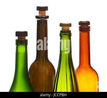 four empty closed wine bottles close up isolated on white background - Stock Photo