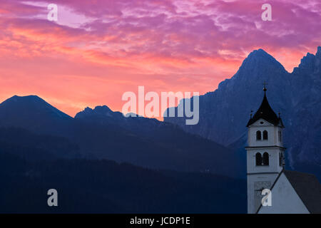 Dolomites Church Colle Santa Lucia at sunrise, Alps, Italy - Stock Photo