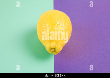 Pop minimal still life photography. lemon isolated on a Pop minimal still life photography. Lemon yellow isolated - Stock Photo