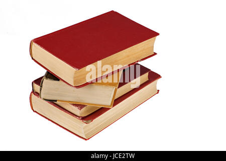pile of old worn books isolated on white background - Stock Photo