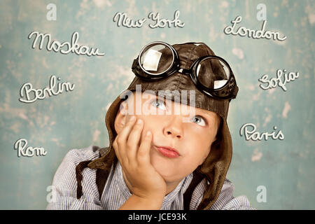 little boy dreams of holidays - Stock Photo