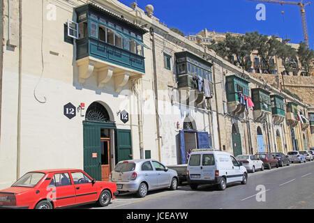 Old merchant house with balcony above warehouse area, Valletta, Malta - Stock Photo