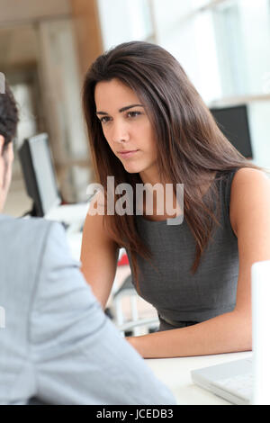 Young woman being interviewed for a job position - Stock Photo