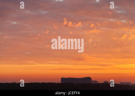 red sunrise clouds over apartment house, Moscow - Stock Photo