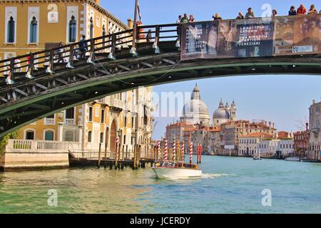 The bridge Ponte dell Accademia with tourists on it, Grand Canal, Venice. Europe. In the background the baroque - Stock Photo