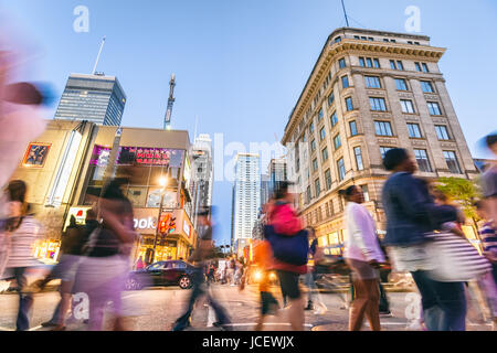 Montreal, 9 June 2017: Motion blur image of people walking on ste Catherine street during grand prix weekend. - Stock Photo
