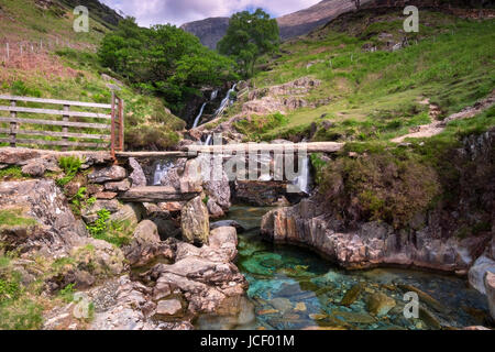 Stone Slab Footbridge and Waterfalls, Cwm Llan, The Watkin Path, Snowdonia National Park, North Wales, UK - Stock Photo