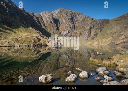 Llyn Cau backed by Craig Cau, Cadair Idris, Snowdonia National Park, North Wales, UK - Stock Photo
