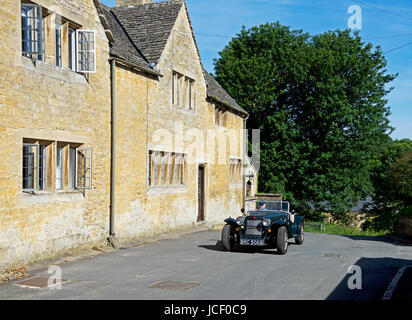 Vintage car in the village of Upper Slaughter, Gloucester, England UK - Stock Photo