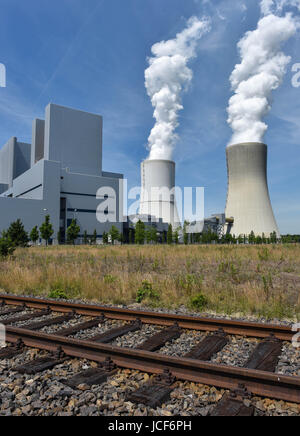 Boxberg, Germany. 15th June, 2017. Water steam rises from the cooling towers of the brown coal fired power plant - Stock Photo