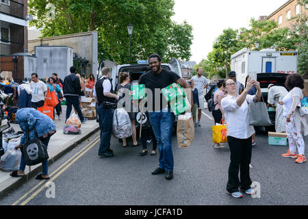 London, UK. 15th June, 2017. Volunteers unloading donations for the residents of Grenfell Tower who lost everything - Stock Photo