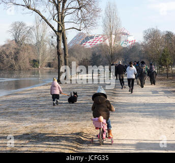 people in park next to Saint James pond, Bois de Boulogne, Paris, France - Stock Photo